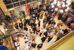 Patrons enjoy drinks and snacks in the lobby of the Paramount Theatre before the beginning of the 10th Anniversary Gala Friday night.